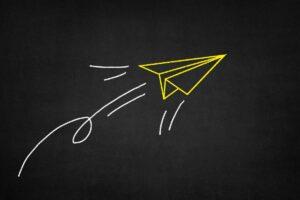 un dessin d'avion en papier symbolisant l'entreprise libérée